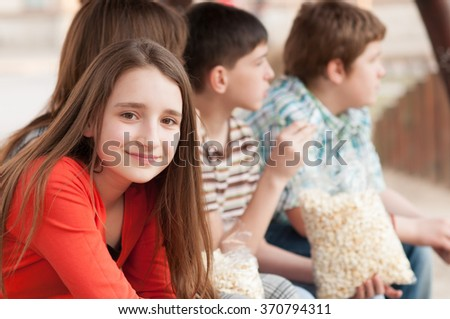 Portrait of beautiful smiling teenage girl spending time together with her friends. - stock photo