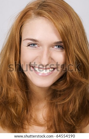 Portrait of beautiful smiling woman - stock photo