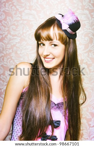 Portrait of beautiful smiling woman in sexy dress and little hat - stock photo