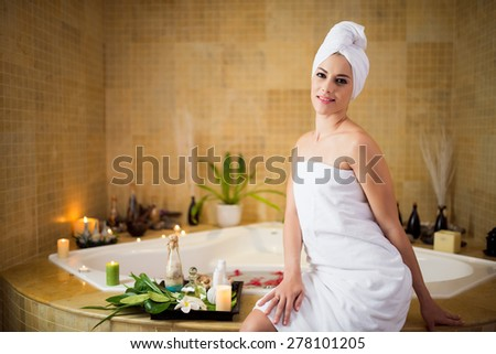 Portrait of beautiful smiling woman in spa salon - stock photo