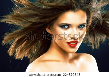 Portrait of beautiful smiling woman with long blowing hair. Hair style portrait.