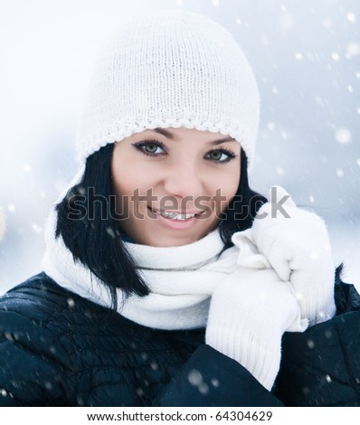 Portrait of beautiful smiling young girl in cold winter day