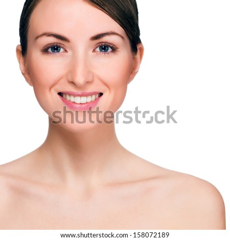 Portrait of beautiful smiling young woman. Isolated on white background - stock photo