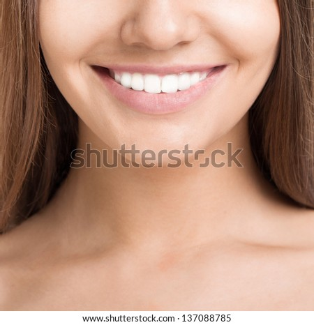 Portrait of beautiful smiling young woman with perfect skin and teeth. Closed up - stock photo
