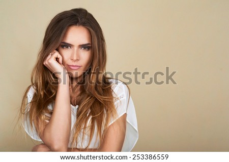 Portrait of beautiful spa woman with professional make up over isolated brown background - stock photo