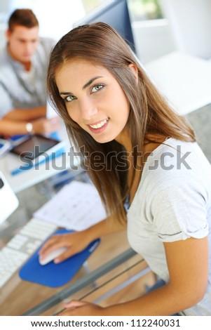 Portrait of beautiful student attending training class - stock photo