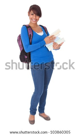 Portrait of beautiful student girl with books. Isolated on white
