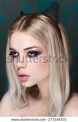 Portrait of beautiful stylish young woman with smokey eyes. Cat style. Big lips. Pure make up - stock photo