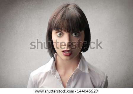 portrait of beautiful surprised woman - stock photo