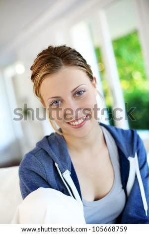 Portrait of beautiful teen girl wearing blue sweater - stock photo