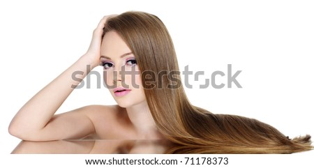 Portrait of beautiful teen girl with long straight hair, isolated on white background - stock photo