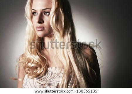 Portrait of beautiful tender blond woman with golden hair - stock photo
