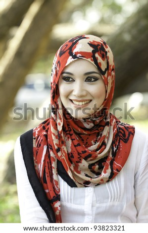 Portrait of beautiful thoughtful muslim woman - stock photo