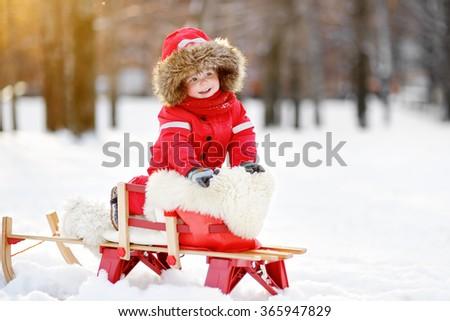 Portrait of beautiful toddler boy having fun in winter  - stock photo