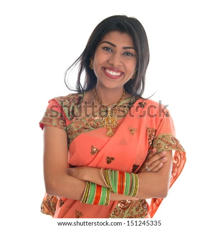 Portrait of beautiful traditional Indian woman in sari dress smiling, isolated over white background.  - stock photo