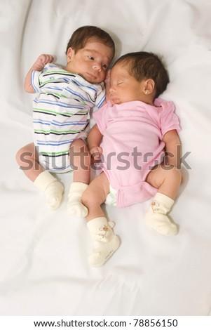 Portrait Of Beautiful Twin Babies Boy And Girl - stock photo