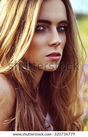 Portrait of beautiful woman at the nature - stock photo