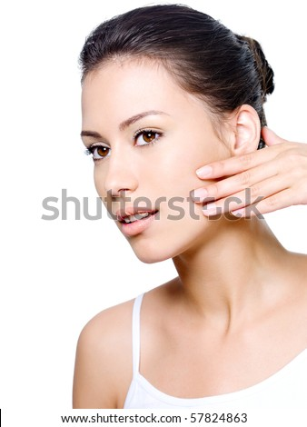 Portrait of beautiful woman checking existence of creases on her face - isolated - stock photo