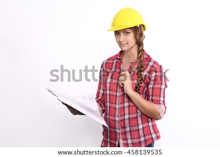 Portrait of beautiful woman construction worker reading blueprints and serious. Isolated white background. - stock photo