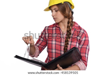 Portrait of beautiful woman construction worker reading blueprints and with a compass. Isolated white background. - stock photo