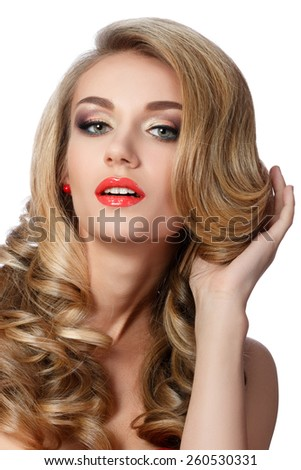 Portrait of beautiful woman doing up her hair. Wedding coiffure and make-up. - stock photo