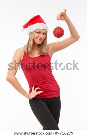 portrait of beautiful woman dressed in santa clause dress and christmas balls - stock photo