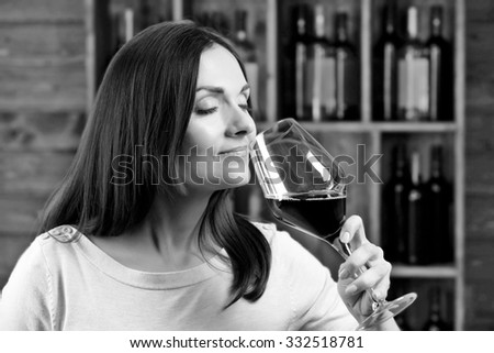 Portrait of beautiful woman drinking wine, black and white retro stylization - stock photo