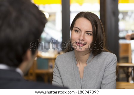 Portrait of beautiful woman during a lunch with a man in restaurant