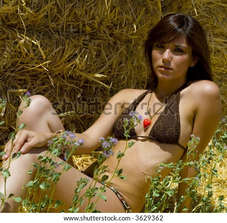 Portrait of beautiful woman enjoying summer in the sun.