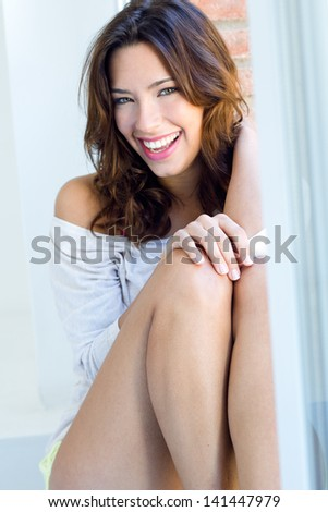 portrait of  beautiful woman girl with smile at home - stock photo