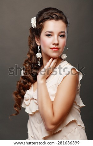 Portrait of Beautiful Woman Hair Wedding Model Over Grey Background. Advertising and Commercial Design. Shopping. Jewelry - Bridal Earrings - stock photo