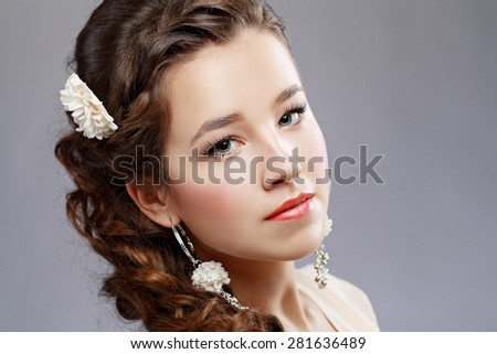 Portrait of Beautiful Woman Hair Wedding Model Over Pink Grey Background. Advertising and Commercial Design. Shopping. Jewelry - Bridal Earrings - stock photo