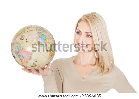Portrait of beautiful woman holding a globe. Isolated on white