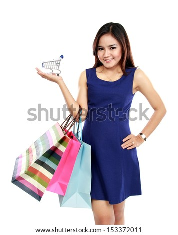 Portrait of beautiful woman holding many shopping bags and shopping chart - stock photo