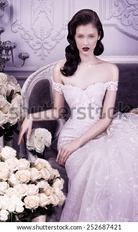 Portrait of beautiful woman in a crystal white gown. - stock photo