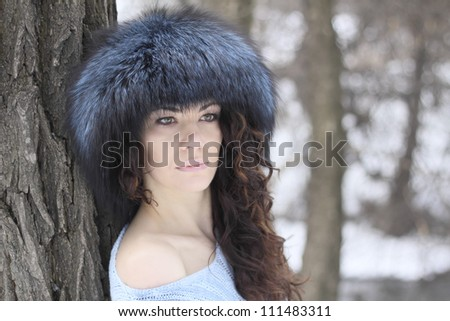 Portrait of beautiful woman in a winter forest