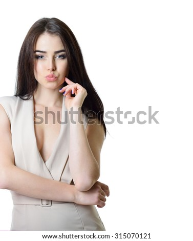 Portrait of beautiful woman in beige dress close up gives kiss - stock photo