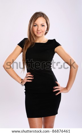 Portrait of beautiful woman in black dress - stock photo