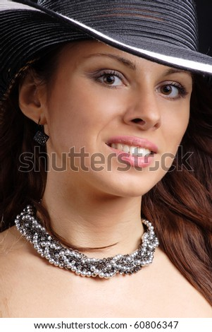 Portrait of beautiful woman in hat black background. More images of this models you can in my portfolio