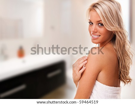 Portrait of beautiful woman in her bathroom - stock photo