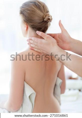 Portrait of beautiful woman in massaging room - stock photo