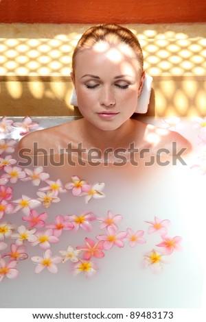Portrait of beautiful woman in milk bath - stock photo