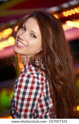 Portrait of beautiful  woman in night city. Shallow DOF. - stock photo