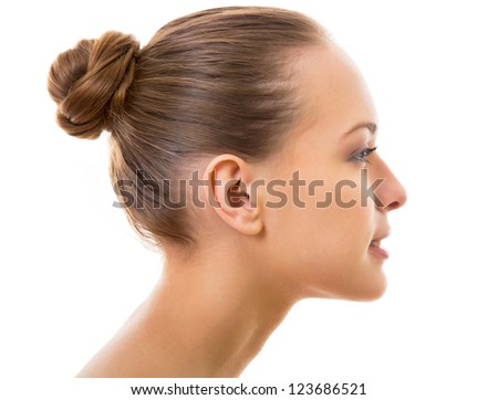 Portrait of beautiful woman in profile on a white background - stock photo