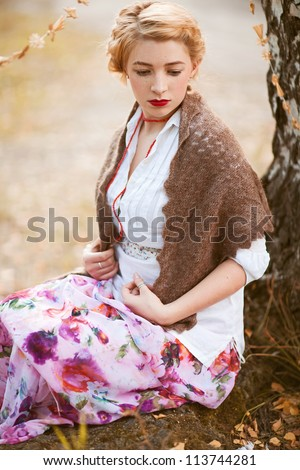 Portrait of beautiful woman in russian traditional dress - stock photo