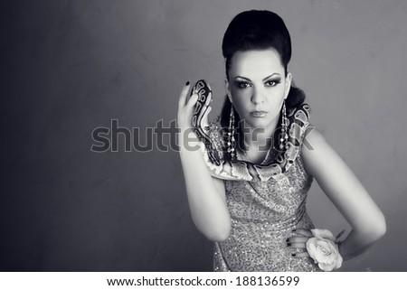 Portrait of Beautiful Woman in studio with dangerous snake - stock photo