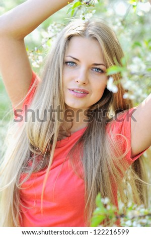 Portrait of beautiful woman in summer - stock photo