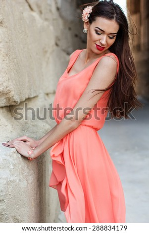 Portrait of beautiful woman is wearing fashion lace orange dress posing in career - stock photo