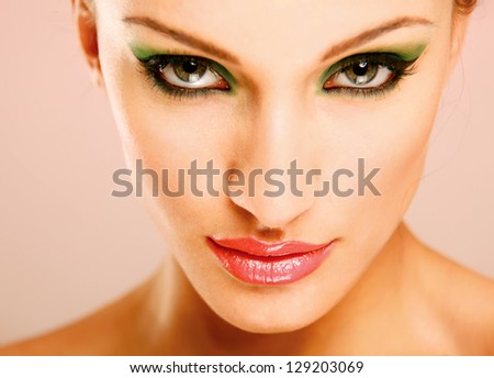 Portrait of beautiful woman, isolated on beige  background - stock photo