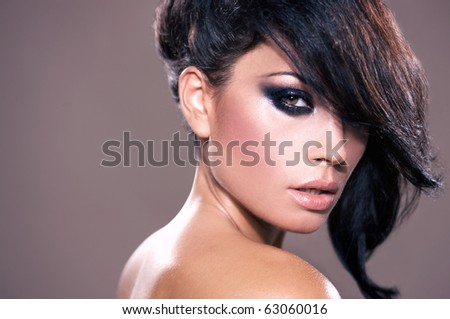 Portrait of beautiful woman isolated on beige with copyspace - stock photo